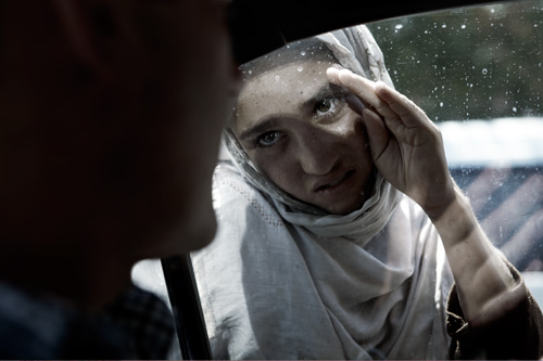 Portrait of Afghan girl in Kabul begging through car window by photographer © Kenneth Rimm Children in Kabul Afghanistan