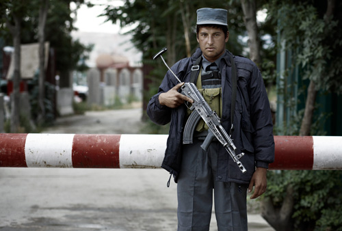 Afghan isaf guard jallabad road Kabul  portraits of afghanistan by photographer Kenneth Rimm