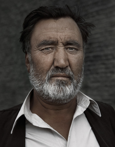 Afghan middle aged man with white beard in Kabul portraits of afghanistan by photographer Kenneth Rimm