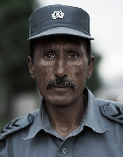 Afghan middle aged police man in Kabul portraits of afghanistan by photographer Kenneth Rimm